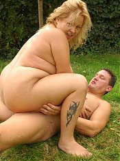Blonde BB Helga enjoys the outdoors as she rides a huge dick on the grass
