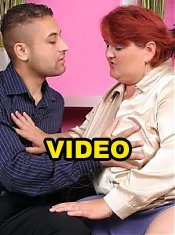 Redhead plumper Hilda fills her mouth with a wang and later rides it with her fat cooter live
