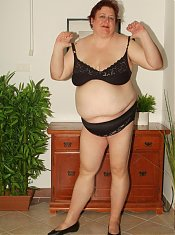 Horny mature BBW Agnes Eva takes her clothes off and rides a cock during a live cam show